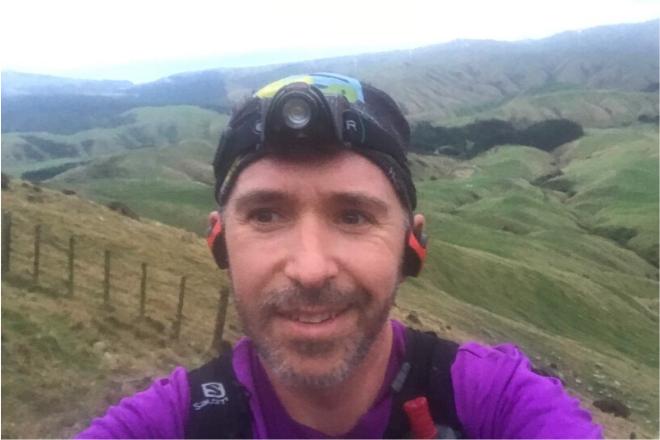 Joe Benbow selfie on a mountain range