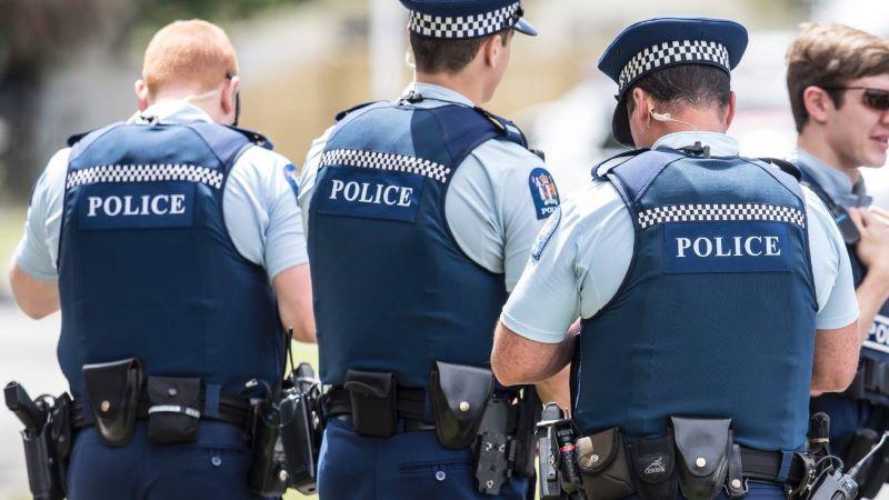 Photograph of backs of three NZ Police