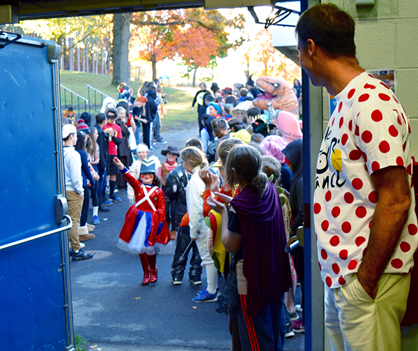 Trey Cassidy Greeting LS Students at Halloween Assembly