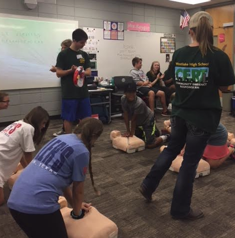 Students teaching CPR to HCMS students