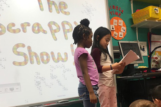 two Tate Woods students present their Scrappy Snowman story