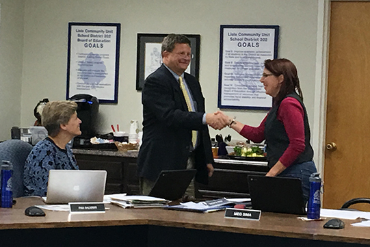 Board President Meg Sima congratulated new member Daniel Helderle