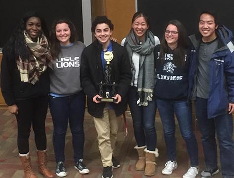 LHS Math team holds their trophy