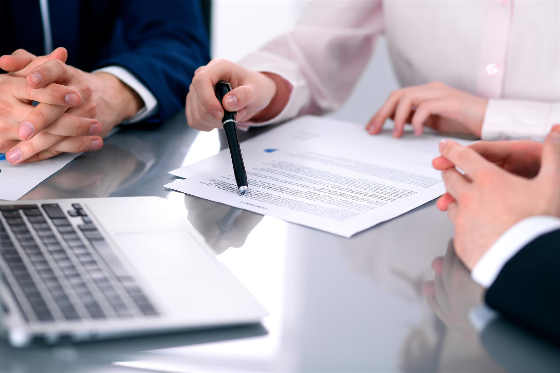 three professionals working on a document - stock photo