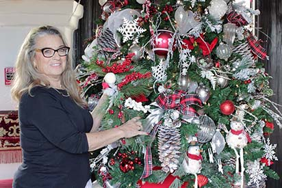 Liz Holt Protell '64 and Christmas tree