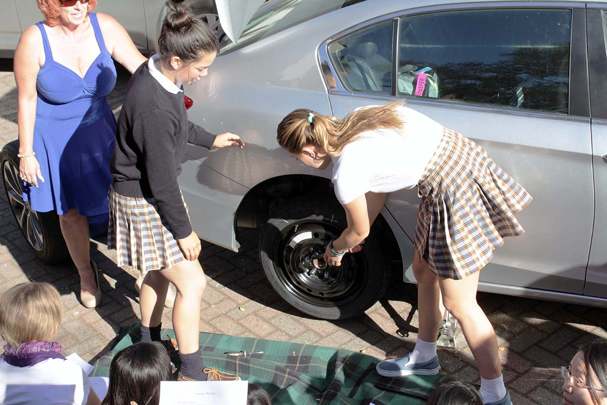Girls changing a tire
