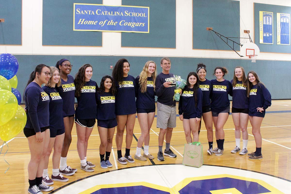 Coach Elliott with volleyball team