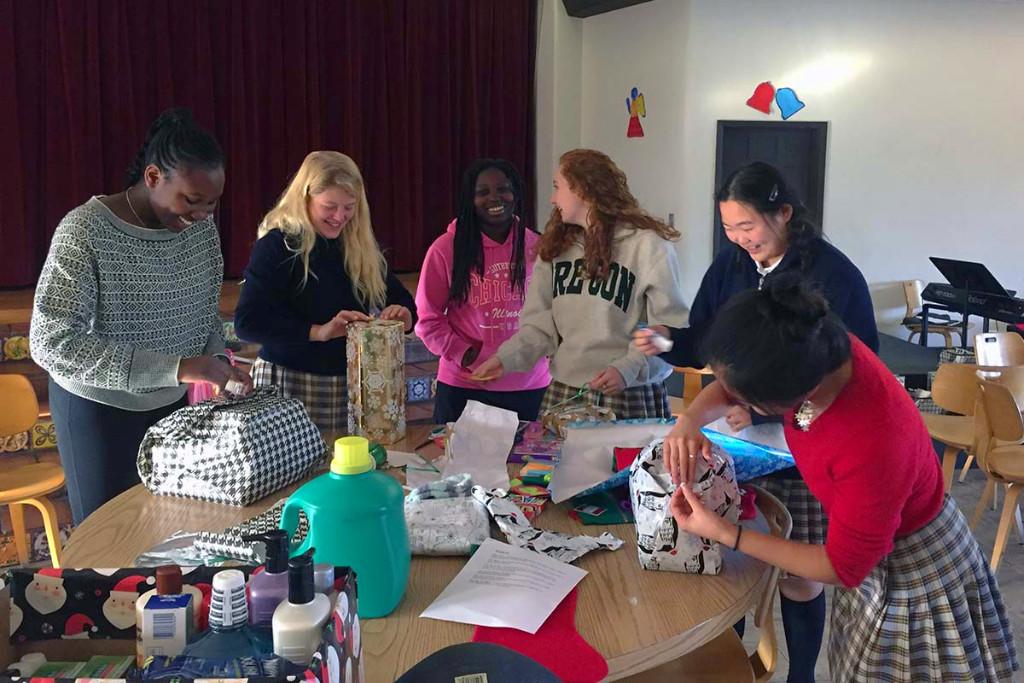 Students wrap presents