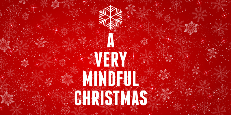 A Very Mindful Christmas Image with red background. Words stacked on top of each other four deep to create an image of a Christmas Tree with a Snowflake on top
